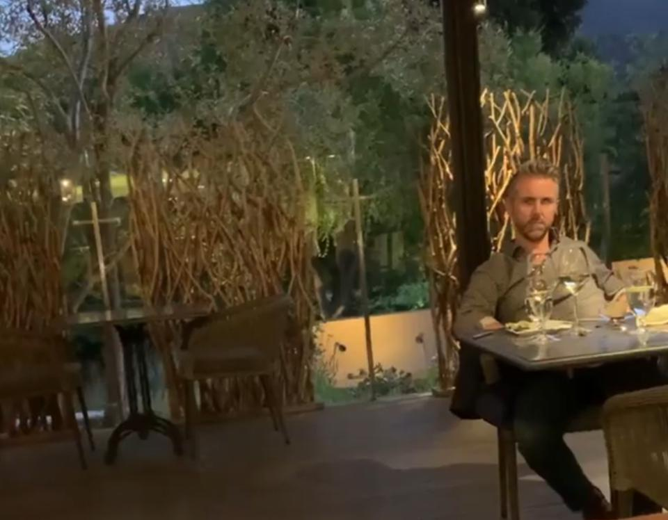 Michael Lofthouse sitting in a chair at a California restaurant, screengrab
