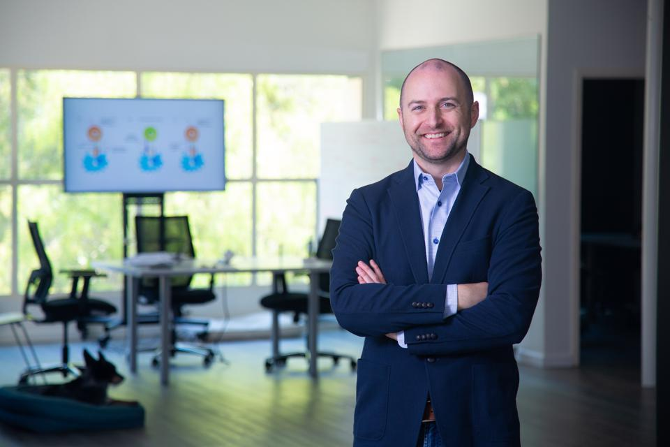 Jason Springs, CEO and cofounder of Endpoint Health stands in his office