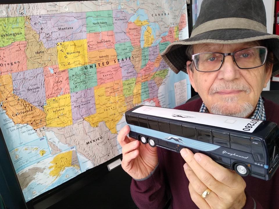 Author Tim Albert and a souvenir Greyhound bus he took home for a friend
