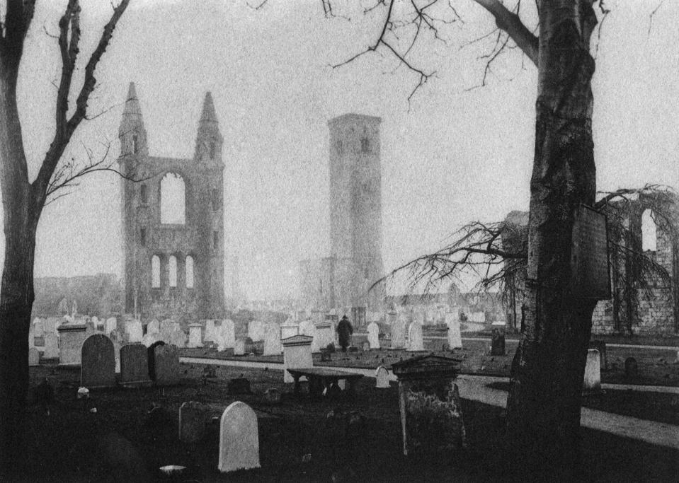 Old Tom Morris walks through a graveyard in St. Andrews toward his son's headstone