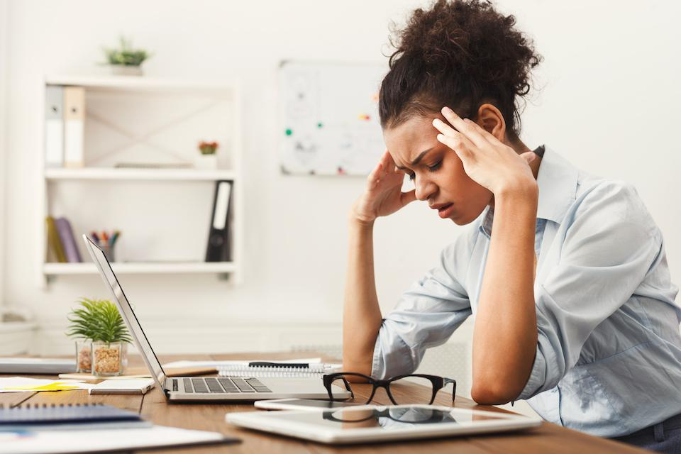 Lifestyle  health  Diet Business Woman At An Office Desk With Who Looks Distressed