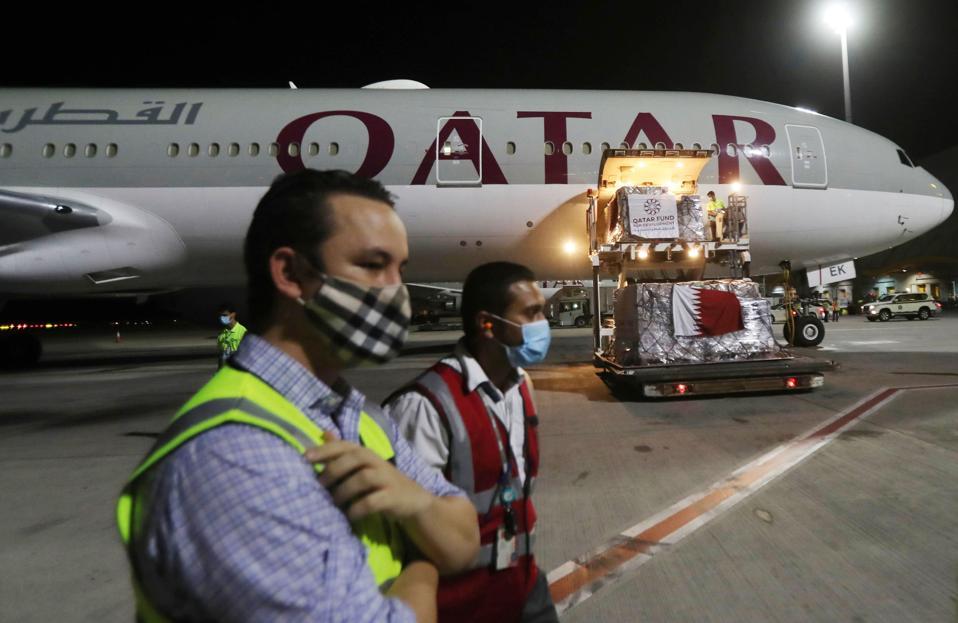 Qatar ground crew wearing masks