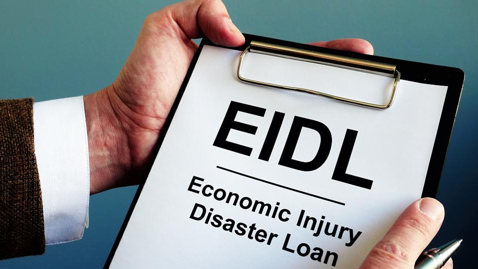 Businessman reads about EIDL The Economic Injury Disaster Loan Program.