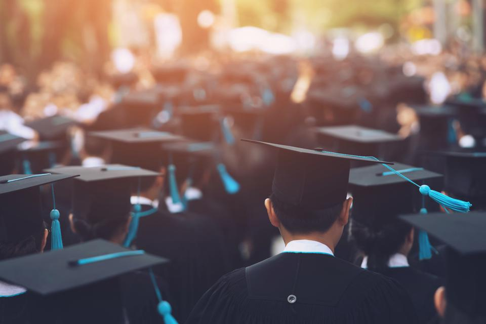 University Students Wearing Mortarboard During Event