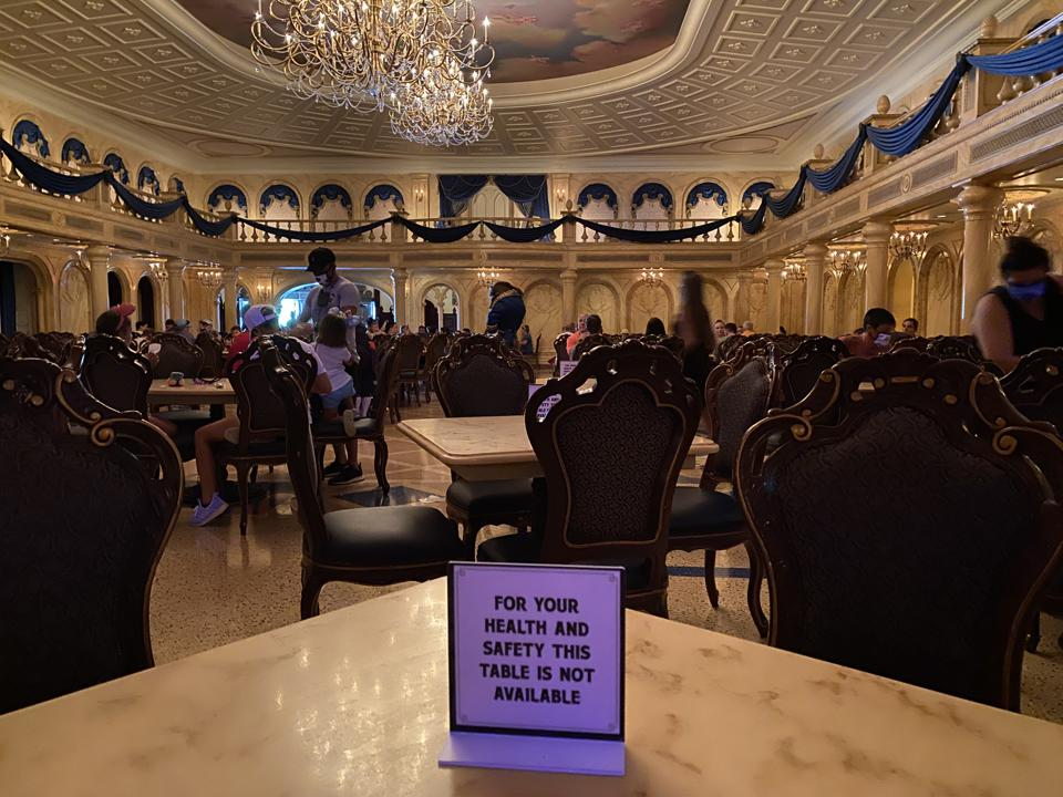A table reserved for social distancing at Be Our Guest, a restaurant inside Disney's Magic Kingdom