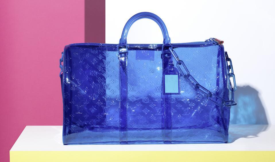 blue PVC handbag on white shelf