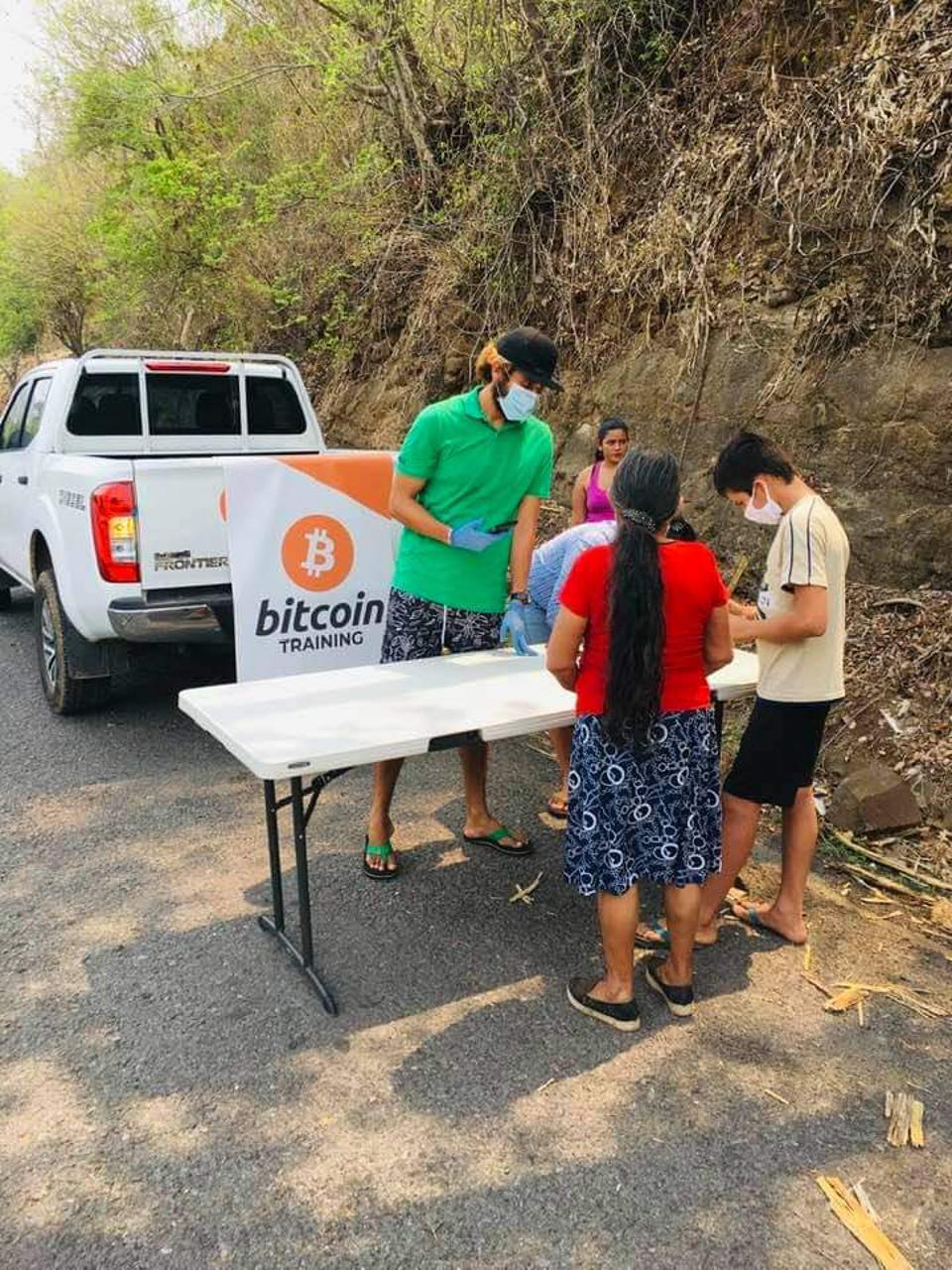"Roman ""Chimbera"" Centeno at a Bitcoin training station in El Zonte. Residents scan a QR code to receive their deposits."