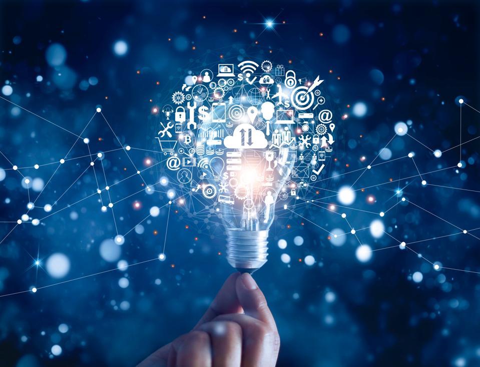 Hand holding light bulb; tech innovation concept