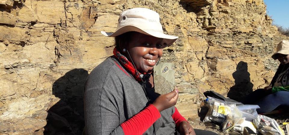 Paleobotanist Aviwe Matiwane on site (Onder Karoo, South Africa), finding fossil plants.