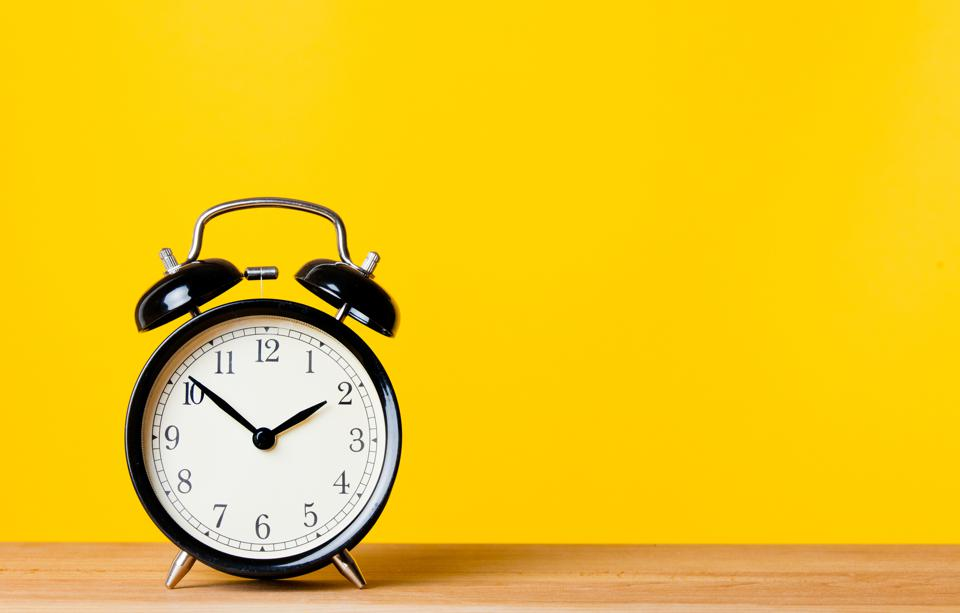 Yellow background with Clock on table