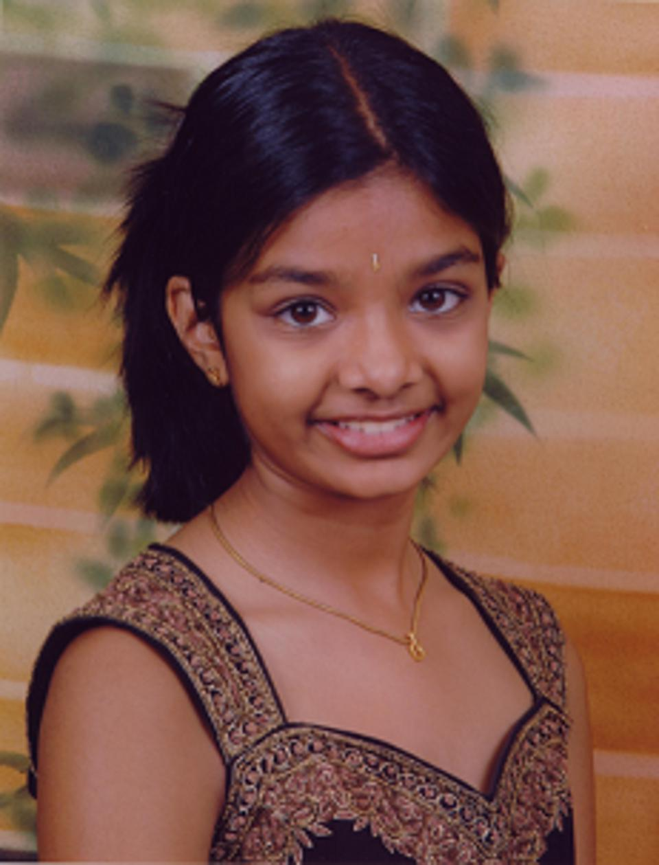 A young Amiti has her photo taken.