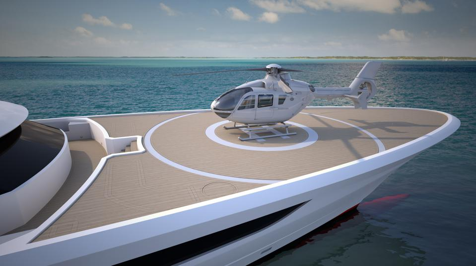 A helicopter lands on the helipad on the bow of the Heesen Yachts Cosmos 80m