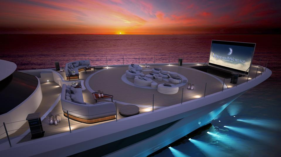 The bow of the Cosmos superyacht is transformed into an open-air cinema at sunset.