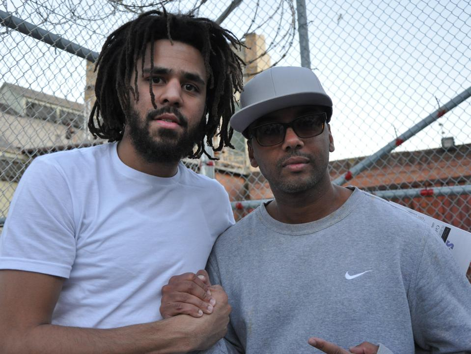 J. Cole poses with Jassy.