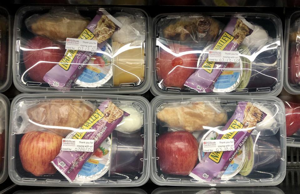 To-go breakfast boxes at Hilton Garden Inn, Wichita, containing fruit, yogurt pastry, etc.