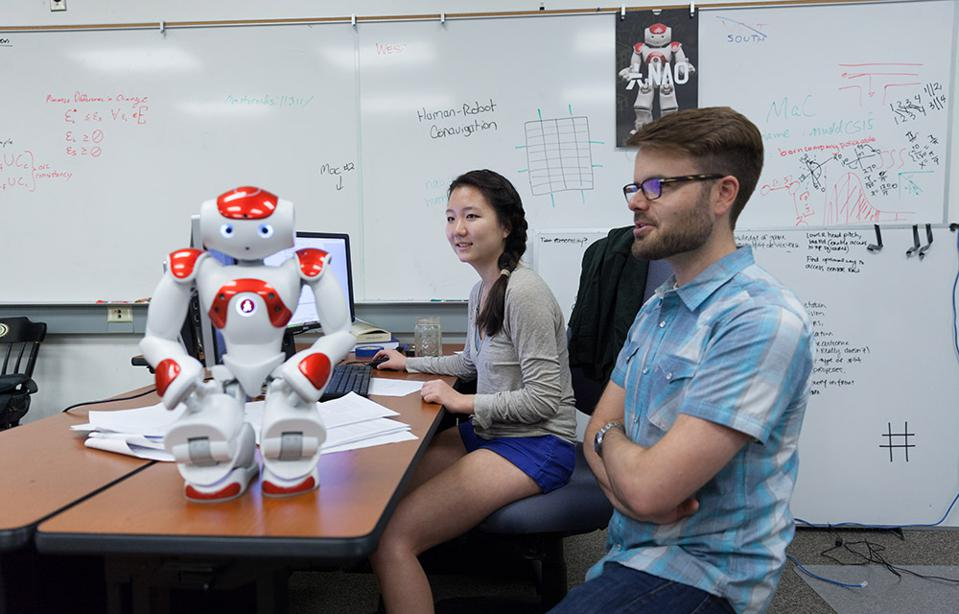 Jim Boerkoel and student with robot