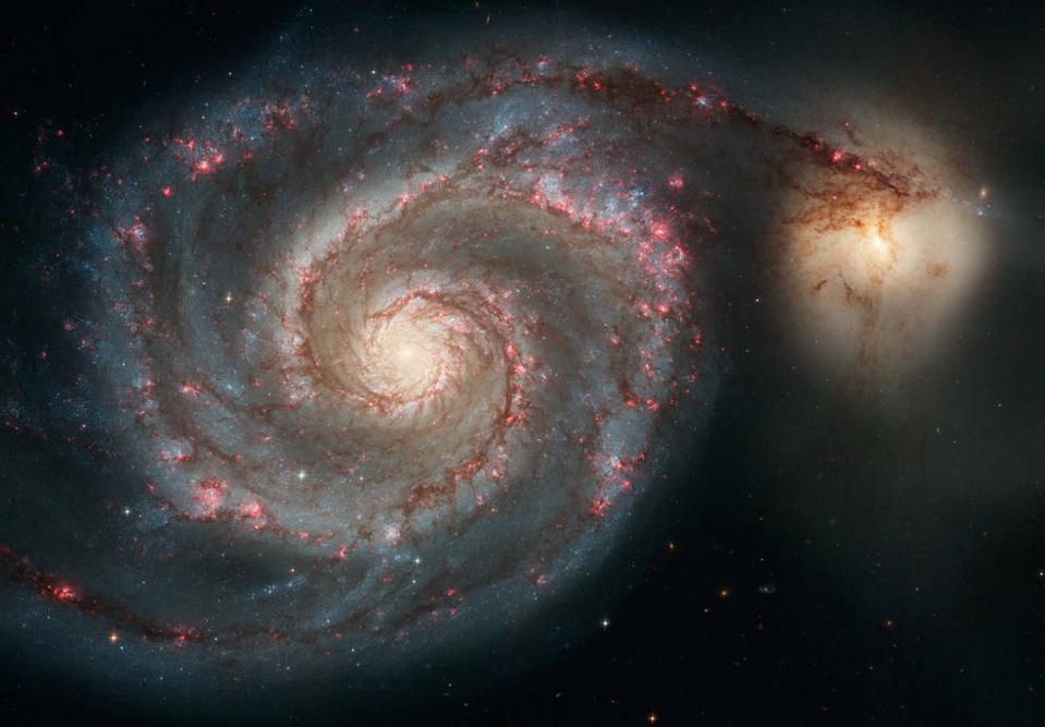 Hubble image of the Whirlpool galaxy, Messier 51, showing its grand spiral arms.