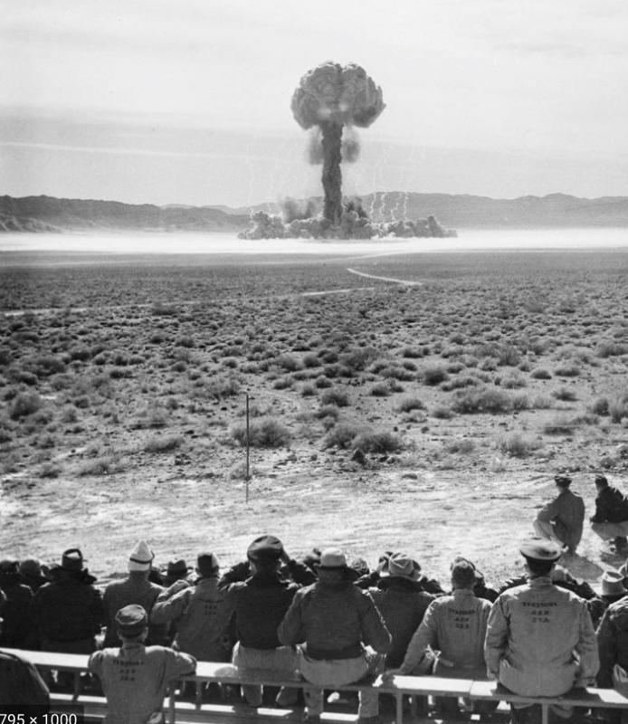Nevada Test Site atomic bomb test with troops looking on