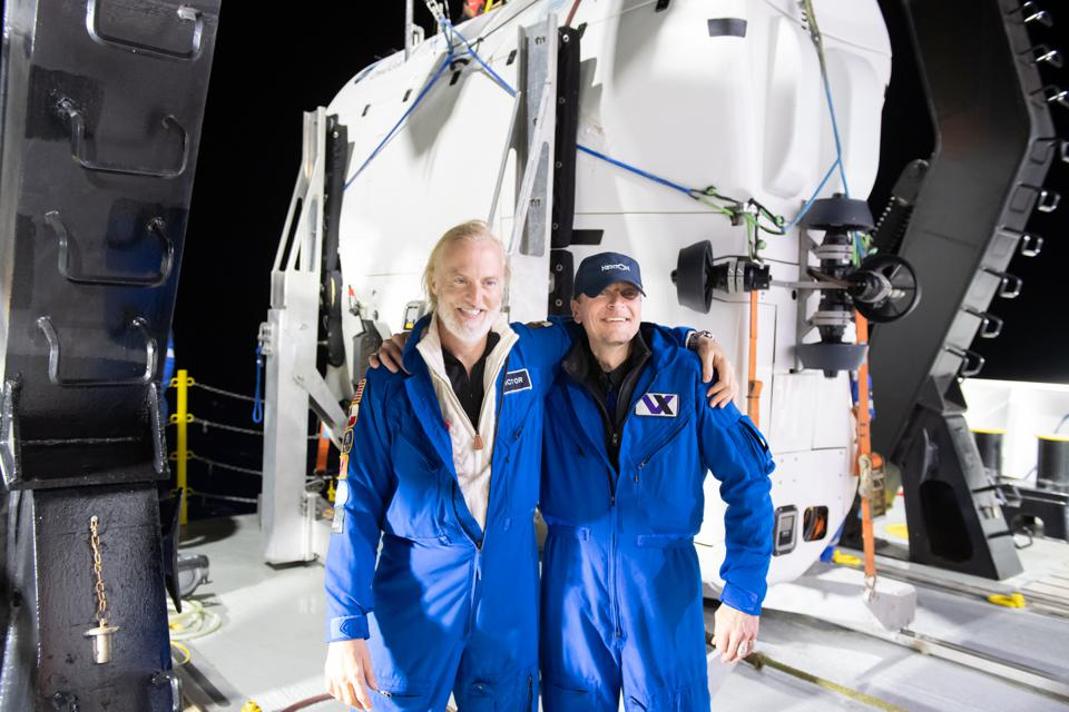 Victor Vescovo (L) and Kelly Walsh (R) come up for air after their successful deep sea expedition.