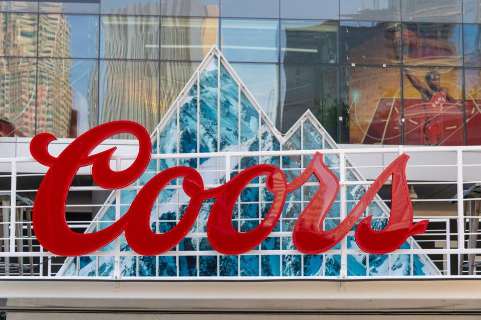 An advertisement logo for Coors beer. The branding design is...