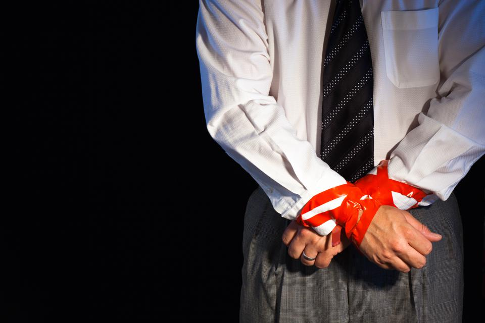 Business man with hands tied