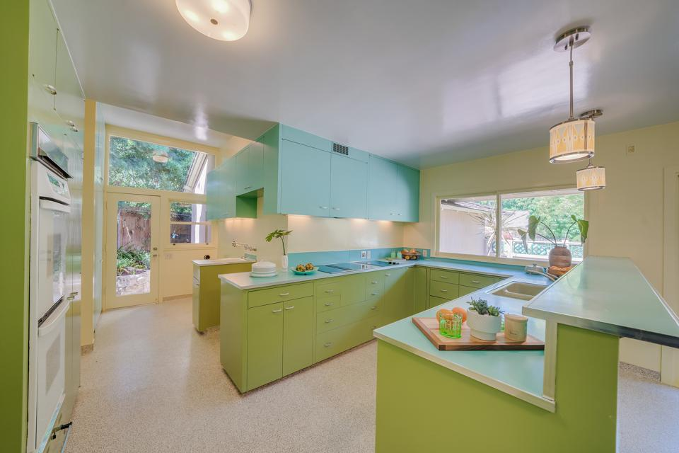 A turquoise and avocado kitchen.