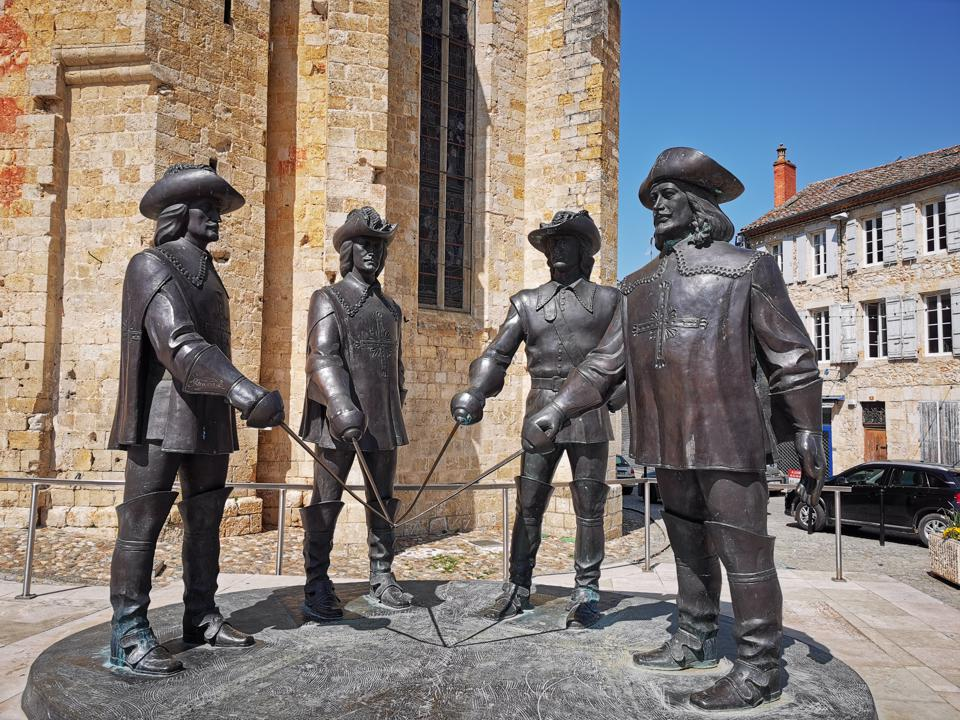 The Musketeers statue in Condom, France, located in the Gers Department.