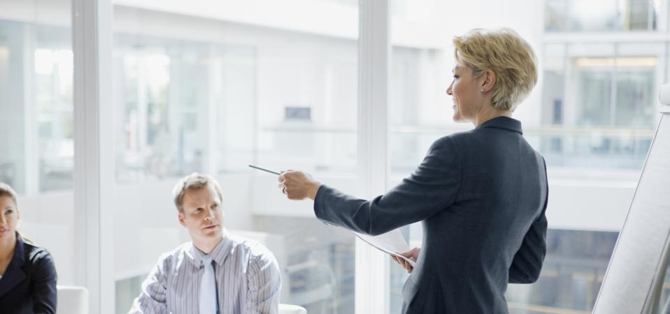 Businesswoman leading discussion in pitch