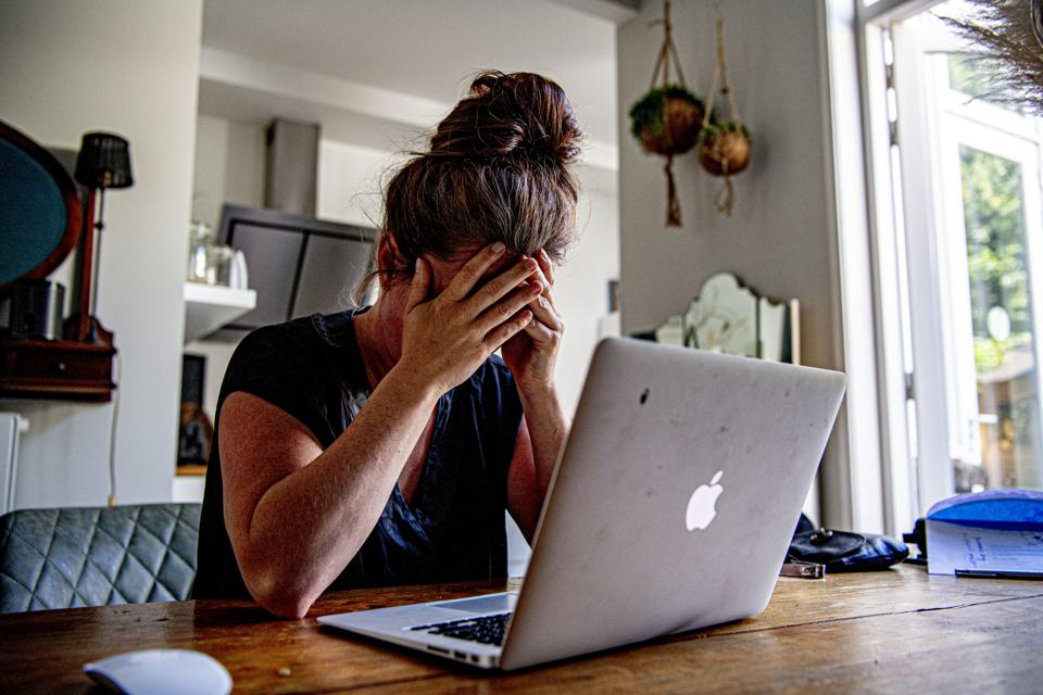 In this photo illustration a woman appears to be stressed as...