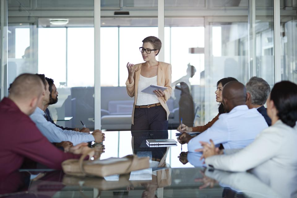 Businesswoman presenting project in meeting room