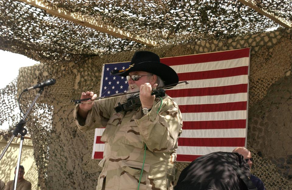 Charlie Daniels performing for the troops in Iraq