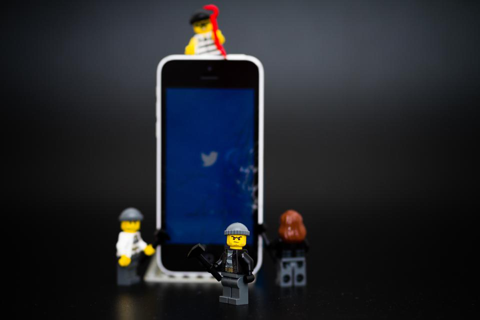 Pictures of hacker looking figures from Lego as well as the Twitterlogo in the background