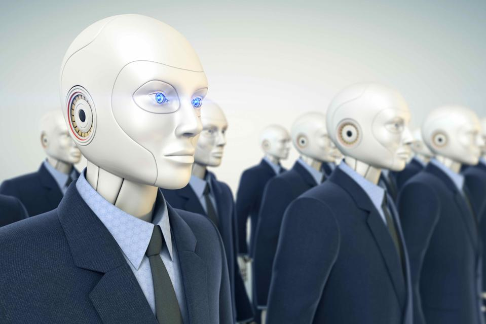 Rows of identical human looking robots dressed in suits..