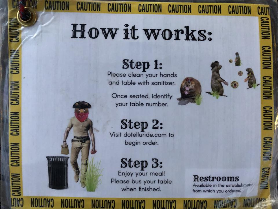 Sign showing procedures for ordering and eating in downtown Telluride, Colorado.