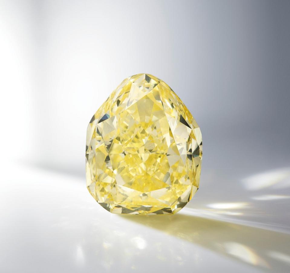 A 104.04-carat internally flawless, fancy intense yellow diamond (estimate $2.6 - $3.7 million)