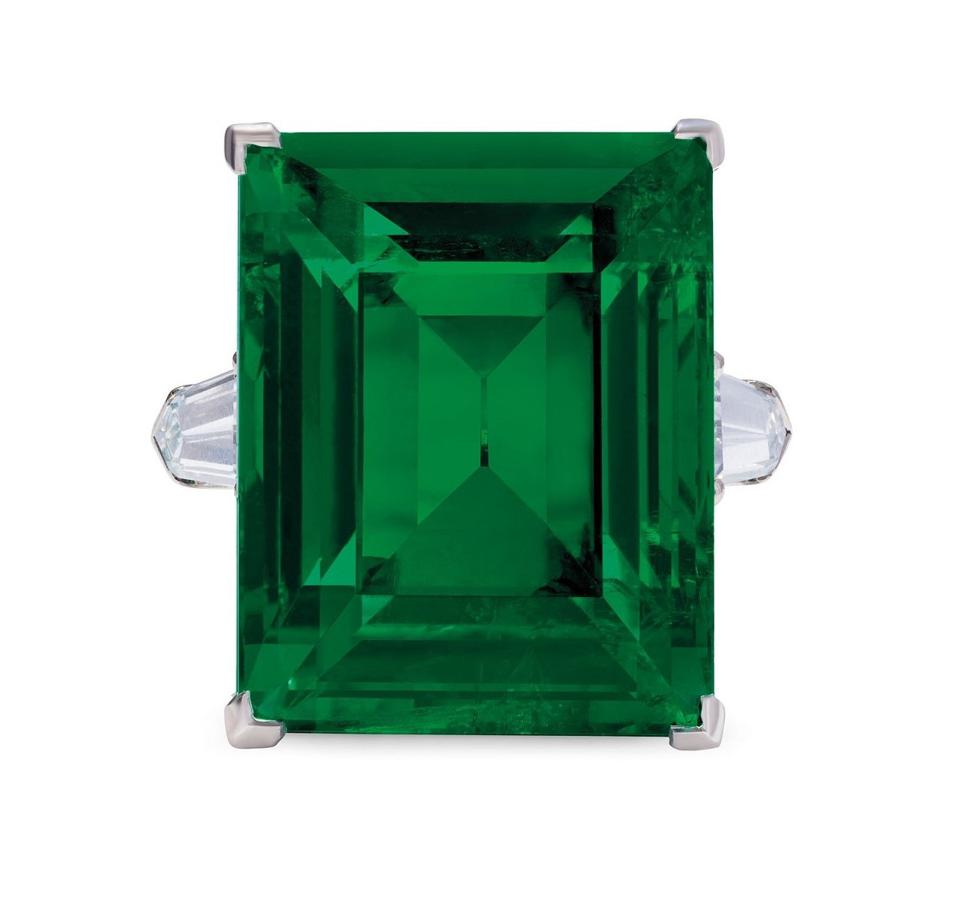 a ring featuring an 29.54-carat octagonal step-cut Colombian emerald with an estimate of $1.2 million - $1.8 million