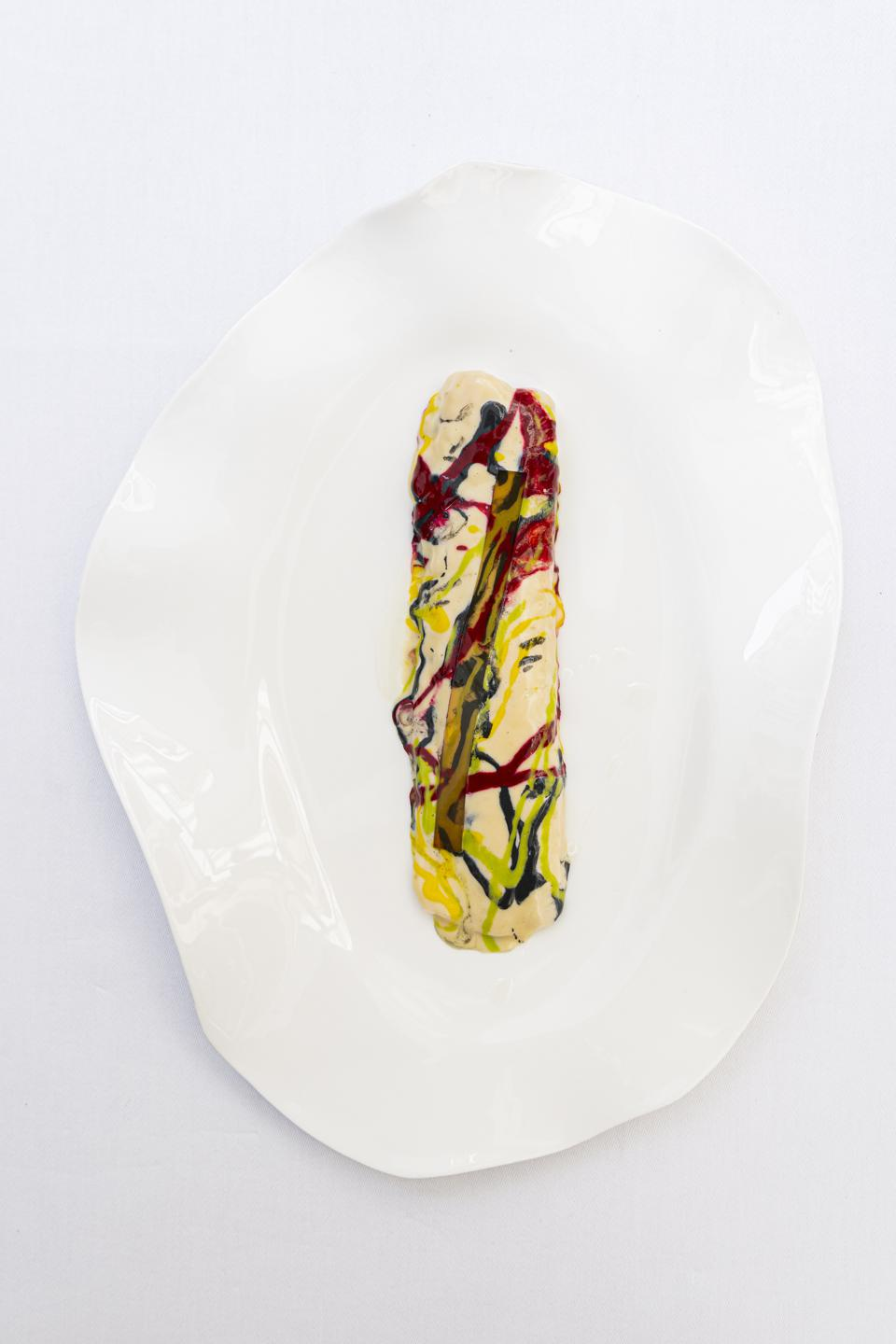 Akrame's signature Jackson Pollock sole, where the Dover sole filet is used as a canvas, with three differently-colored sauces dripped on it