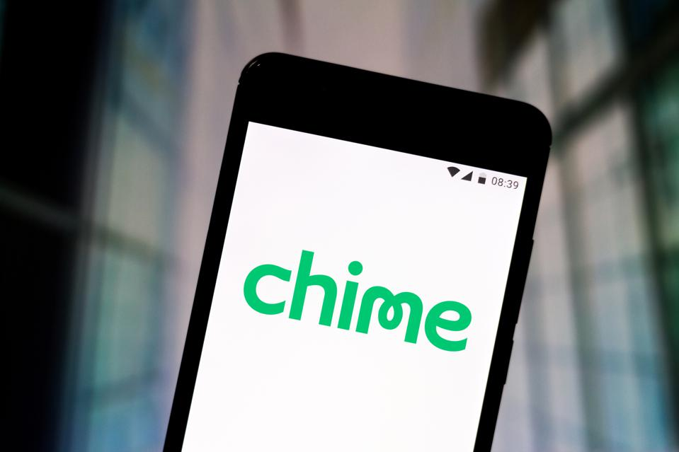In this photo illustration the Chime Banking logo is seen...