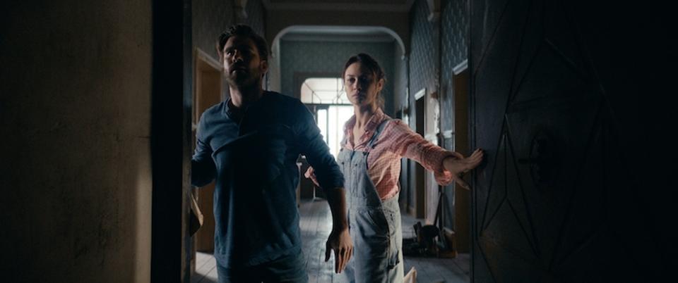 Kevin Janssens and Olga Kurylenko in 'The Room.'
