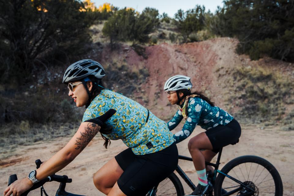 Cycling with friends. Women adventurers.