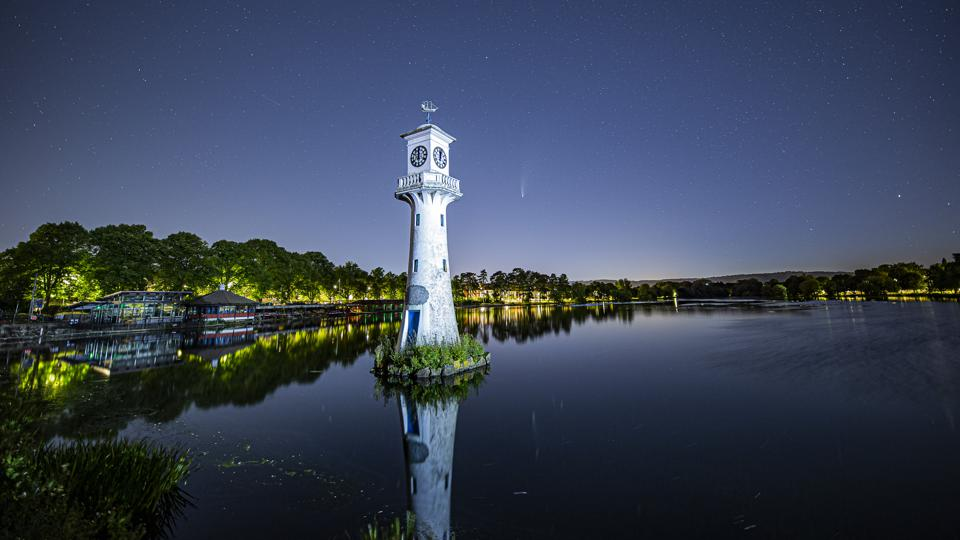 Comet NEOWISE reflected in Roath Park Lake in Cardiff, Wales. The clock tower is a memorial from 1913 to Scott and the British Antarctic Expedition of 1910, which left from Cardiff.