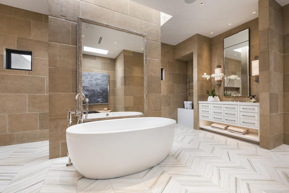 Upscale bathroom with stand-alone tub