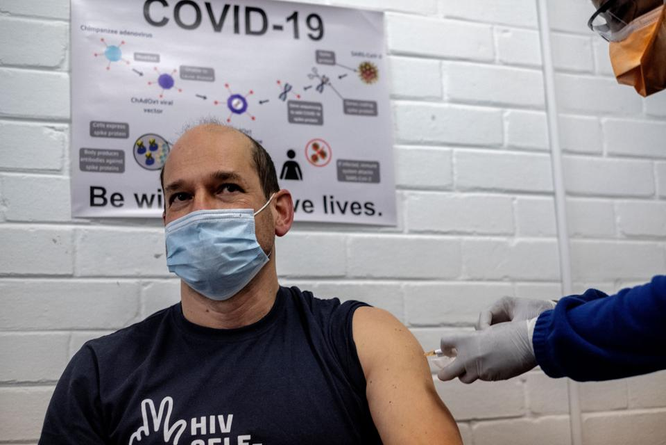 A man receives an experimental vaccine for the coronavirus.