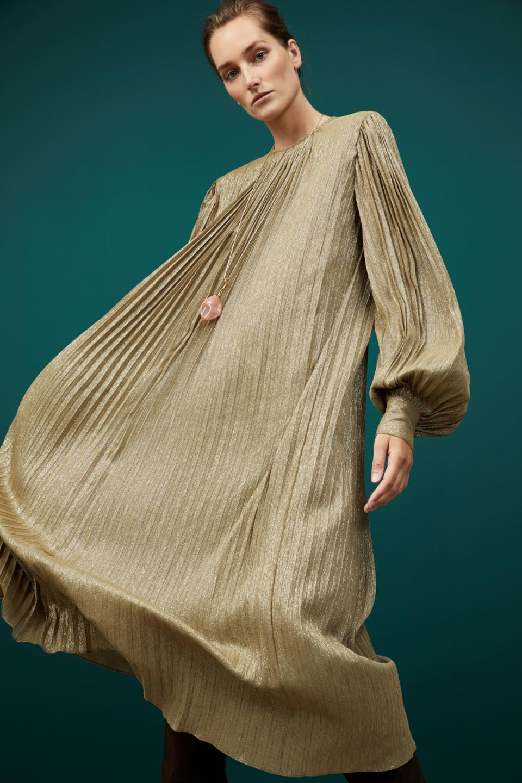 Woman in long flowing gold dress