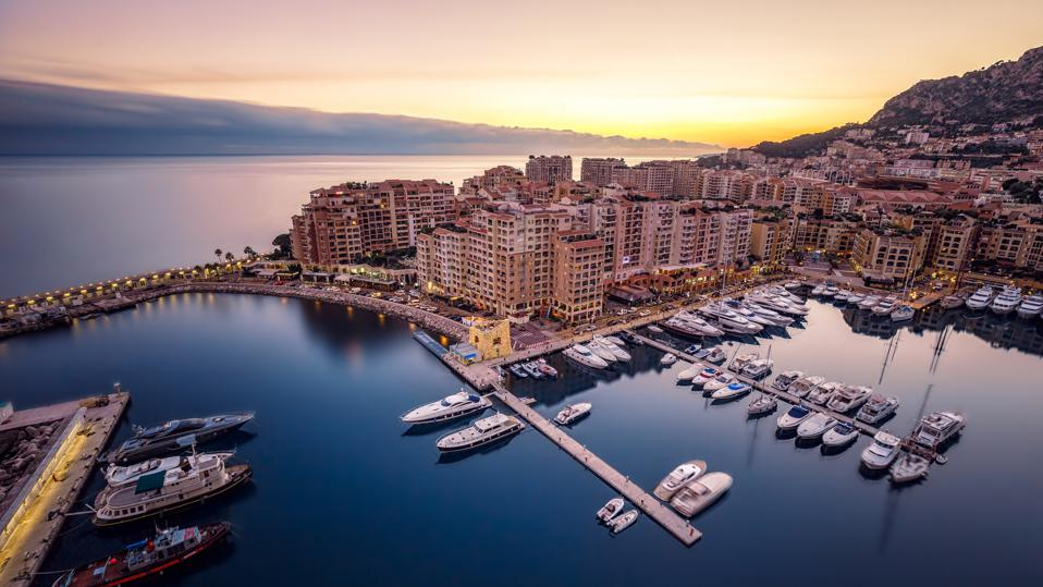 Monaco, Monte Carlo at dusk; The Anderson Media Group represents several high-profile, luxury clients in the area.