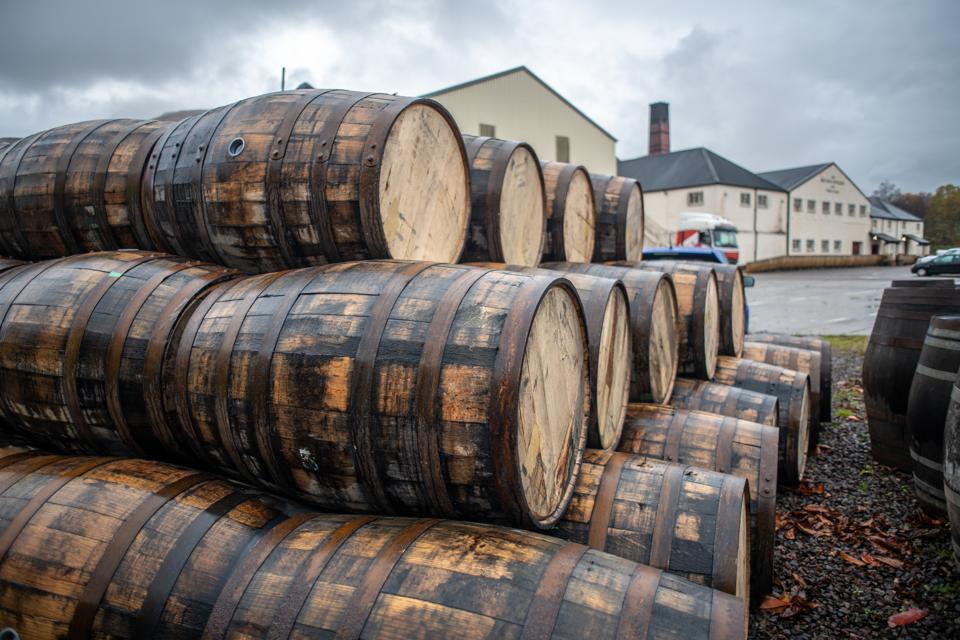 Barrels stacked at Ben Nevis Distillery for whisky aging process in Fort William, Scotland