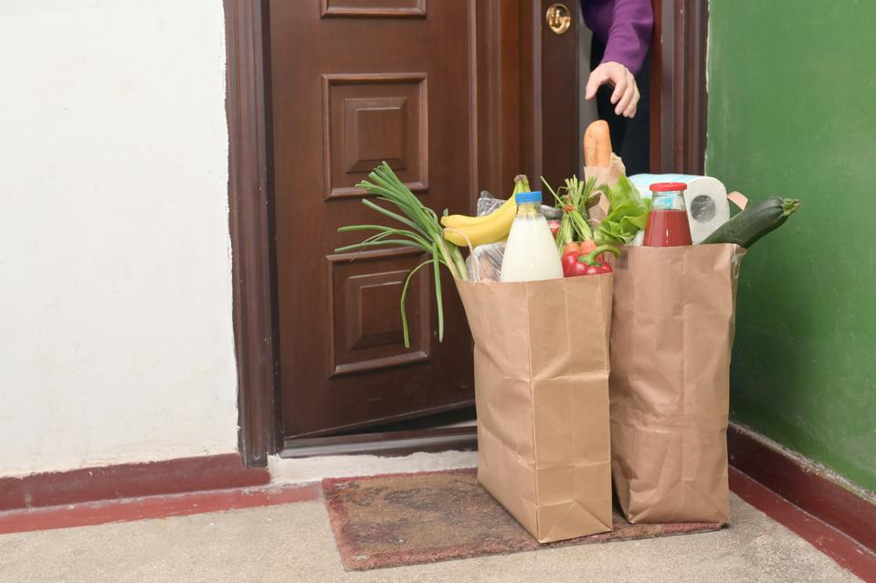 Delivering Food To A Self-isolating Woman at Home