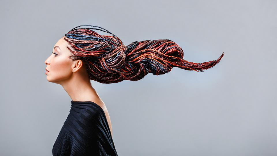 Fashion studio shoot of a mixed race woman with a creative colorful dreadlocks hairstyle