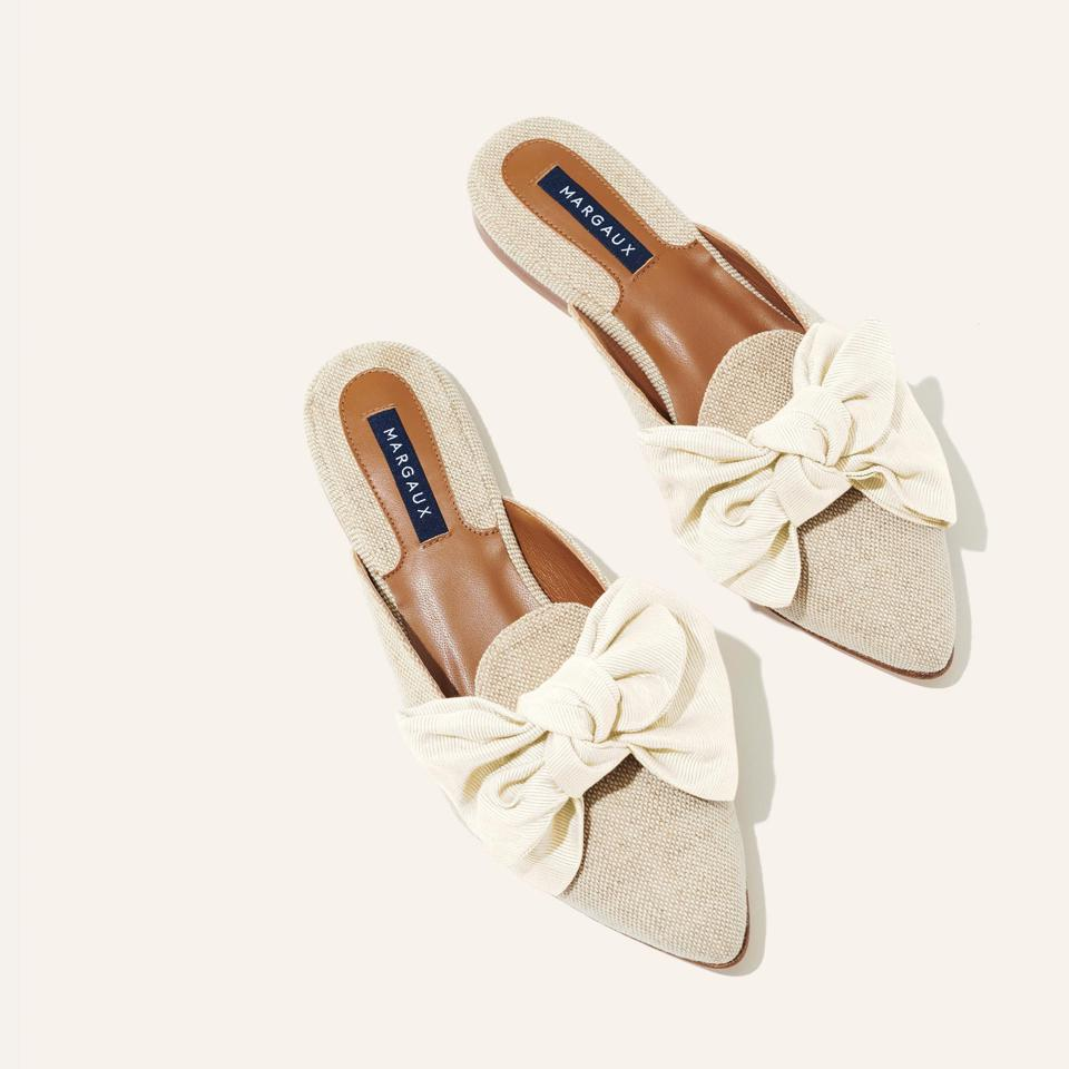 A silhouette inspired by traditional smoking slipper, but a backless, slip-on style gives it a laidback sensibility. The classic smoking slipper toe feels feminine thanks to an oversized bow.