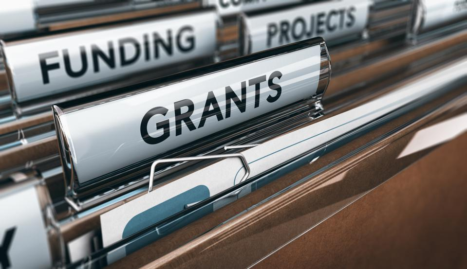 File folders, with a big one labeled 'grants.'